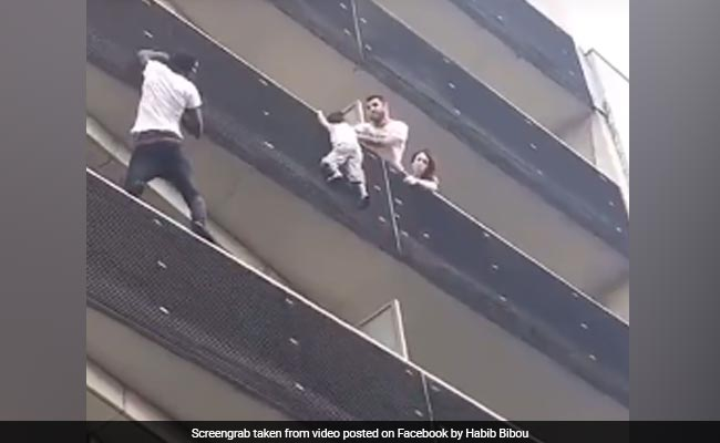 real spiderman story. man saved child hanging off the ledge by climbing four floors