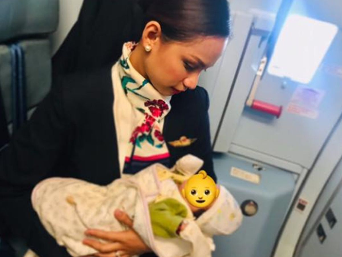 This Air Hostess Breastfeeds The Baby Of A Strange Woman