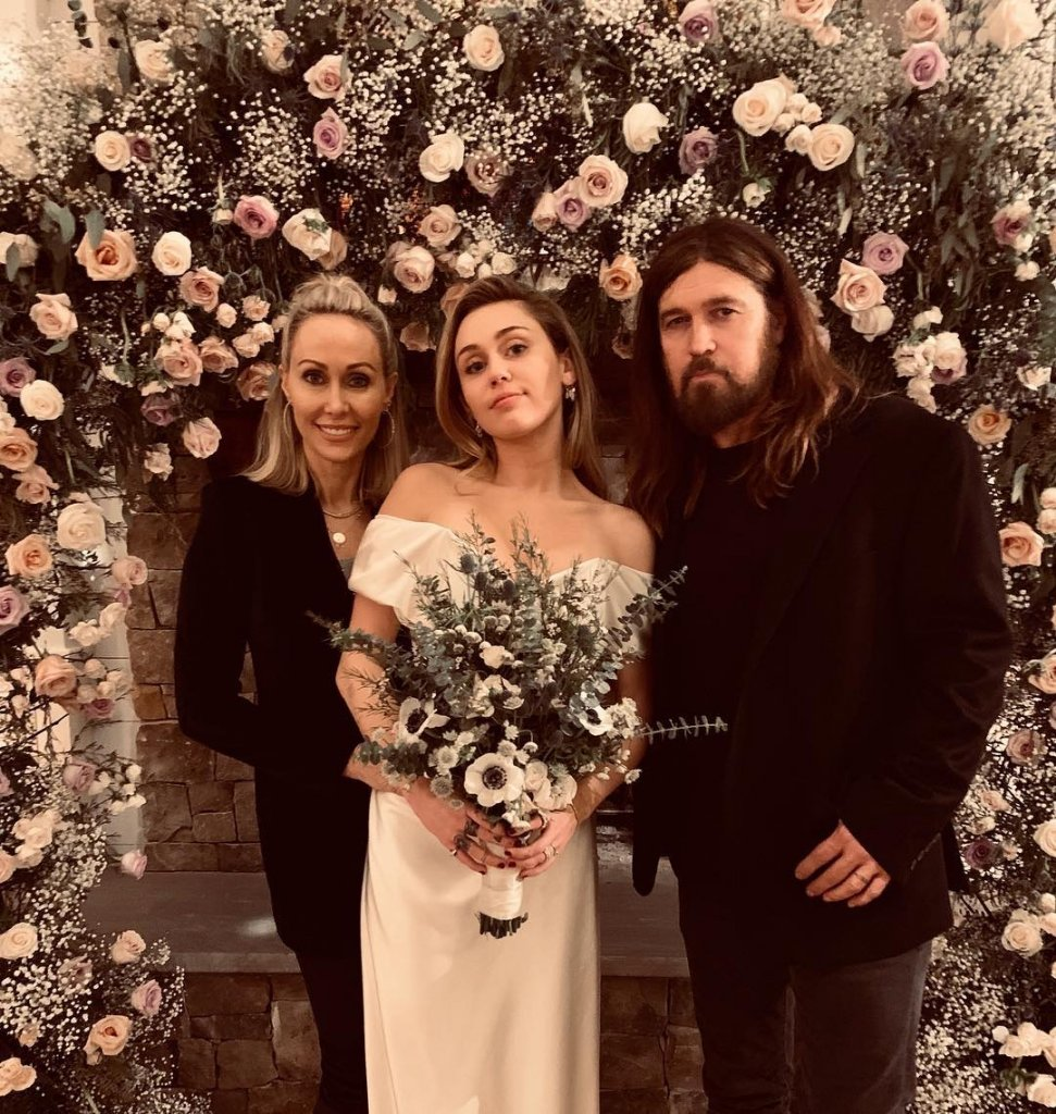 Miley Cyrus Looks Elegant In Her First Wedding Pictures As She Poses With Her Parents