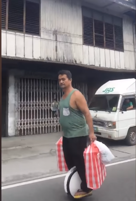 Filipino Waiter Delivers Food On A Hover Unicycle With Full Swag