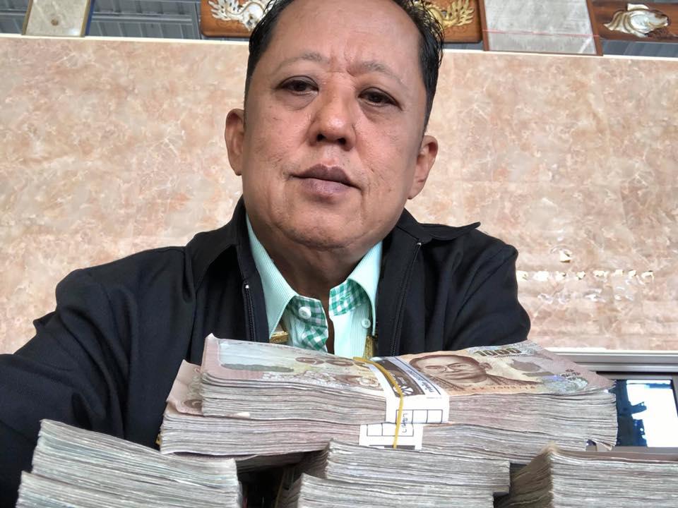 Thai millionaire farmer Arnon Rodthong giving money to marry his daughter