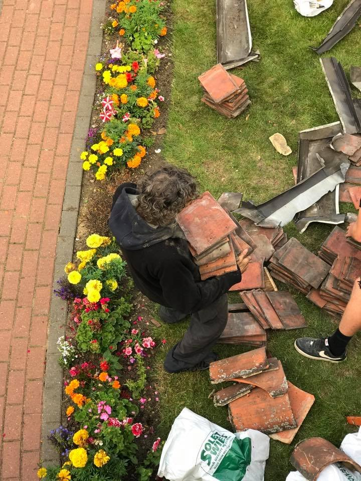 Roofers help homeless man with work