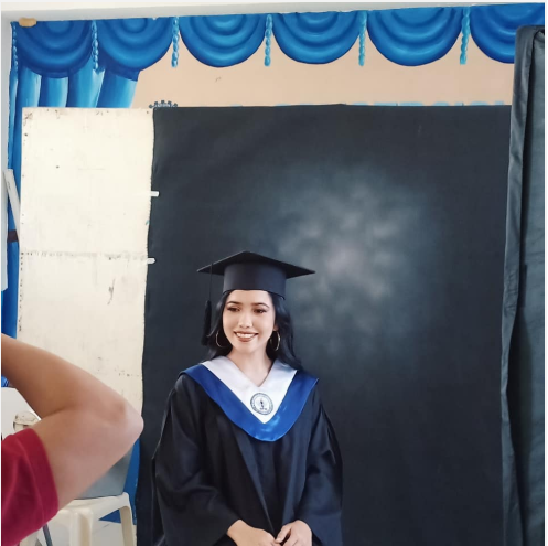 Aira poses in her graduation robe for a photoshoot arranged by her boyfriend