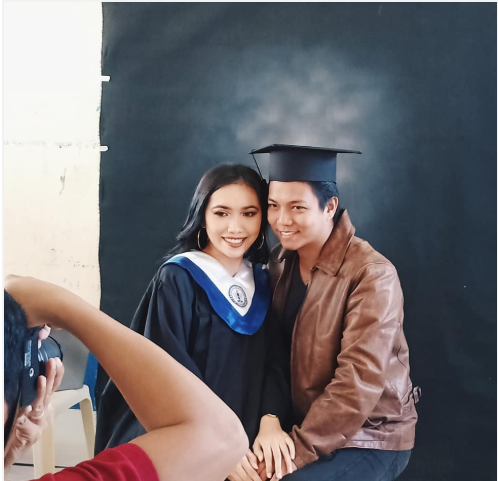 Aira and her boyfriend both pose with a graduation gown and a hat