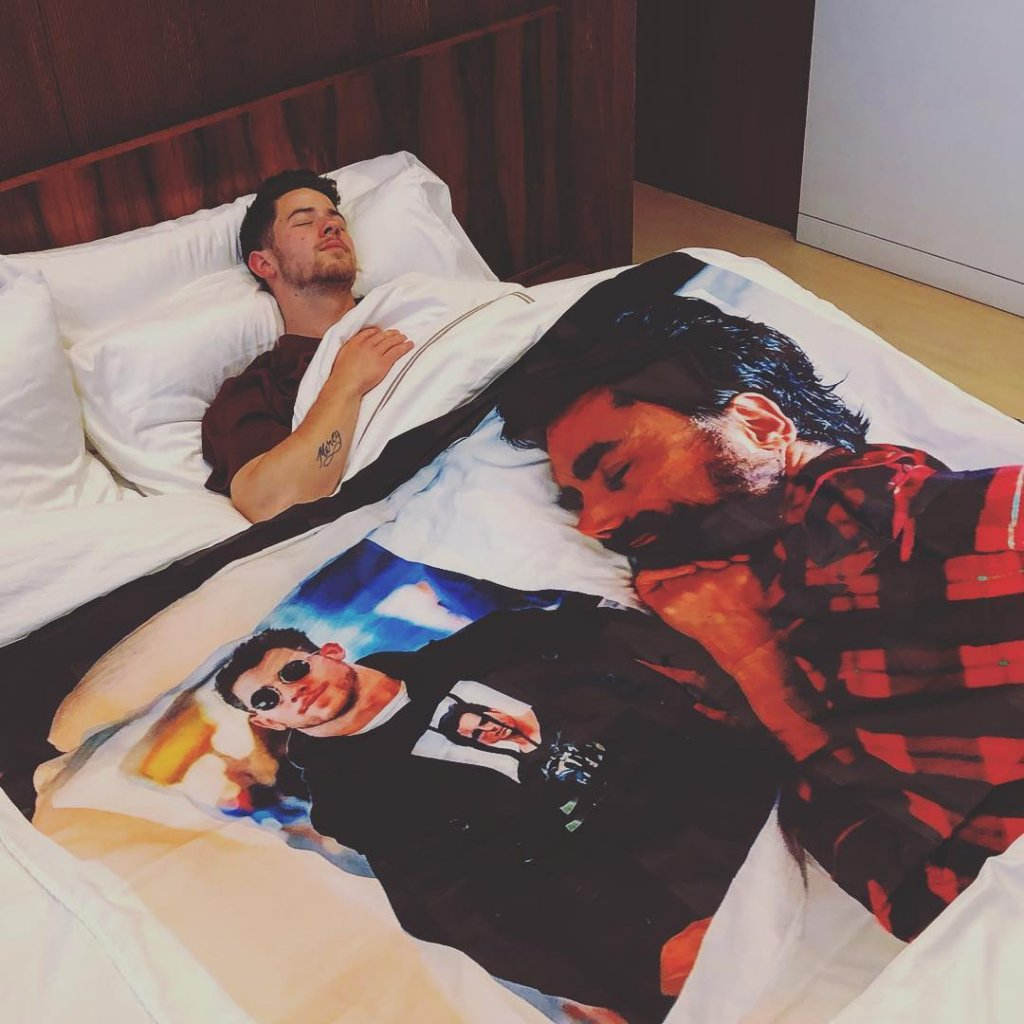 Nick Jonas And John Stamos Are Trolling Eachother