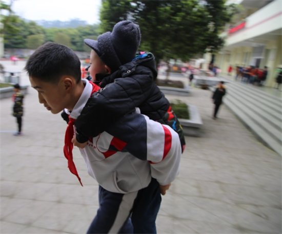This 12 Year Old Boy Carried His Best Friend To Class On his Back Everyday For Six Years