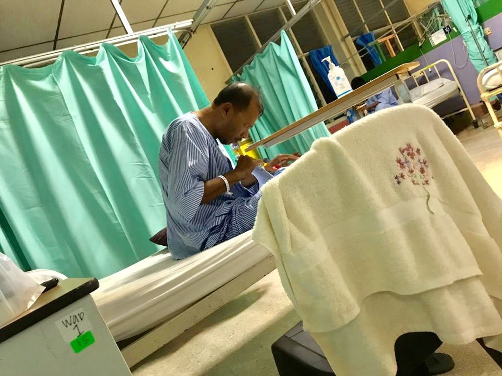 Teacher Corrects Exam Papers in Hospital