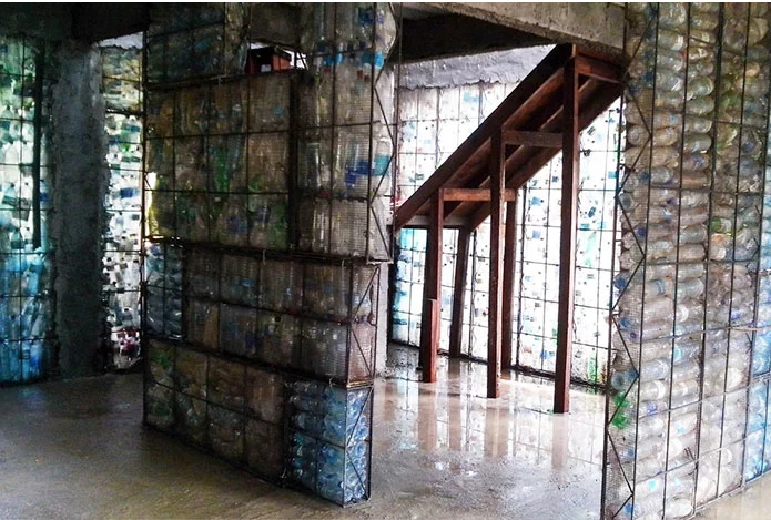 man creates Plastic Bottle Homes