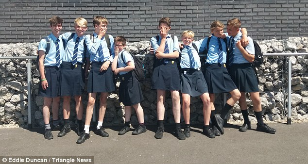 Boys in high school choose to wear skirts after management bans them from wearing shorts in high temperatures
