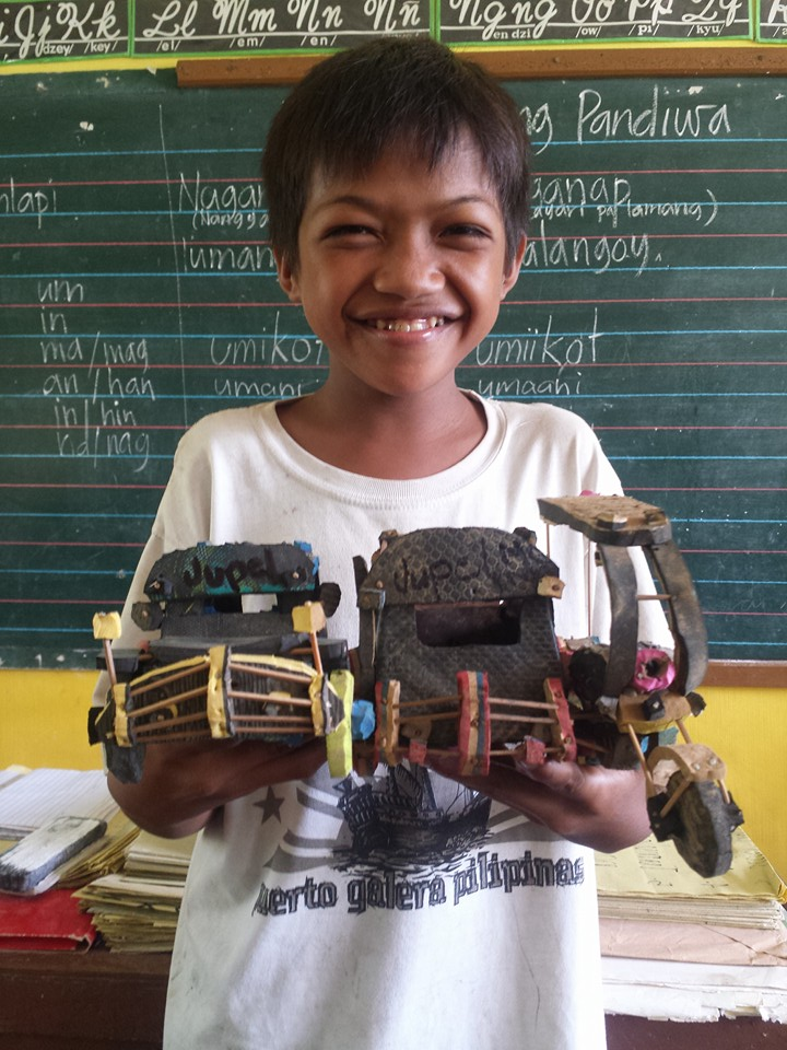 13 Year Old Poor Boy Transforms Discarded Rubber Slippers Into Model Cars