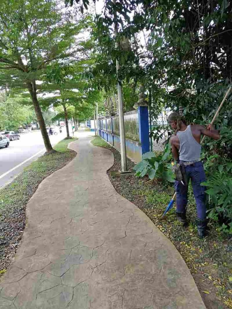 Man Clean Street in Malaysia for Free