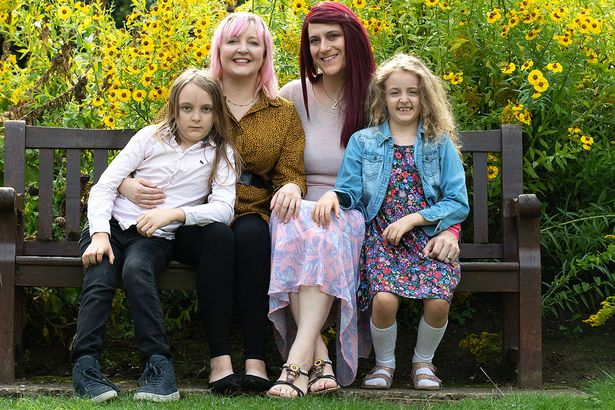 The happy family with a same gender couple after husband transforms into a woman
