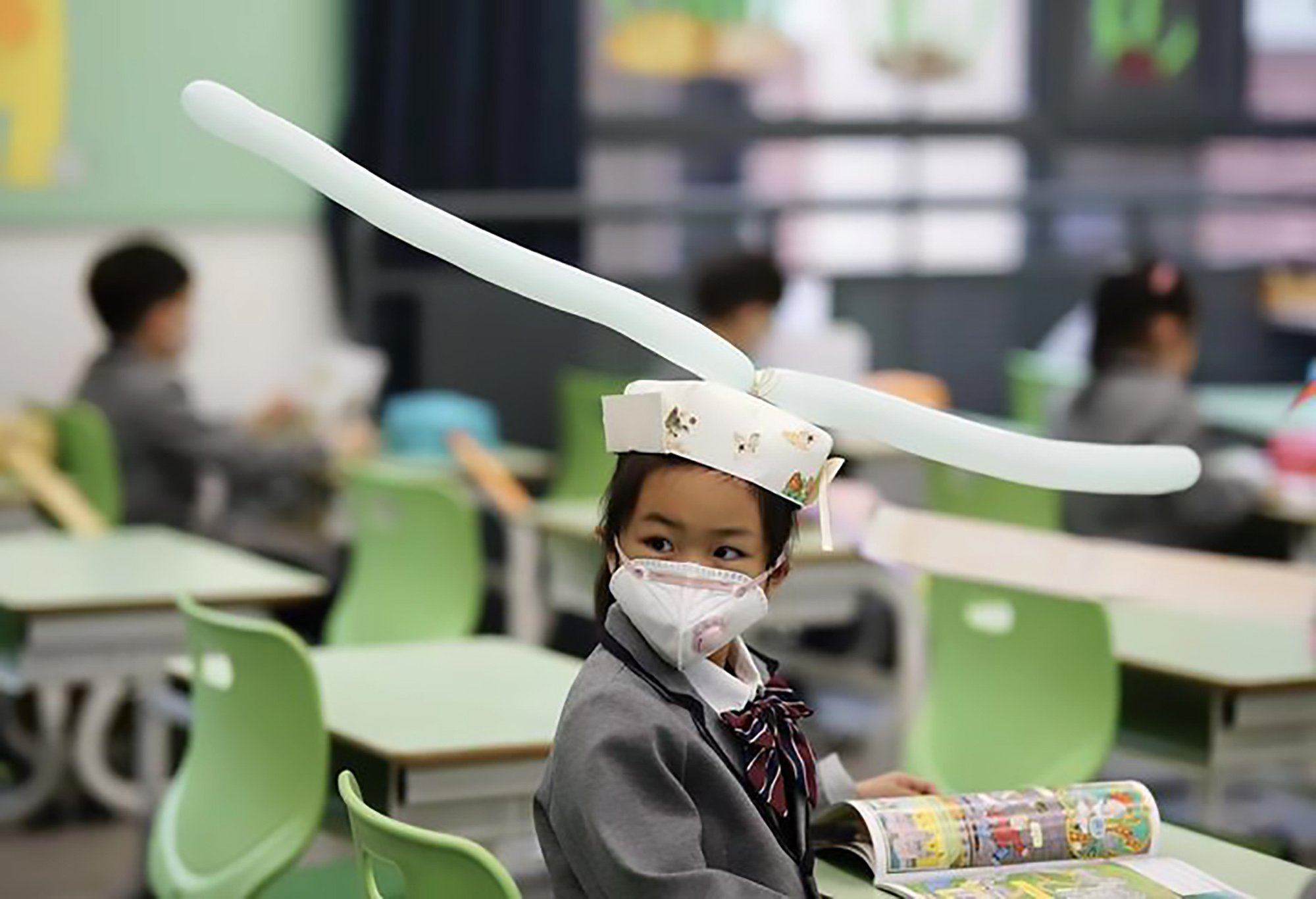 Kids in China Return To School With Home-made Social Distancing Hats