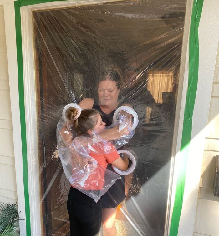 Little Girl Invents Hug Curtains Made of Plastic To Hug Her Grandparents Amid Pandemic