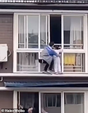 Chinese Man Scales Tall Building With Bare Hands To Save A Kid Hanging from Balcony
